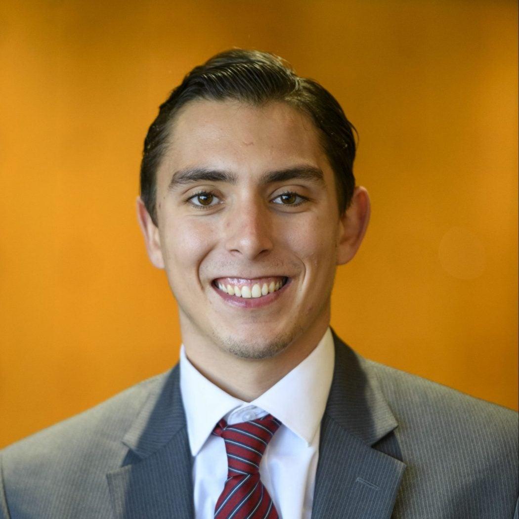 Headshot of Alexander Mederos smiling.