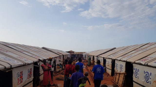 People walk through a refugee camp in South Sudan.